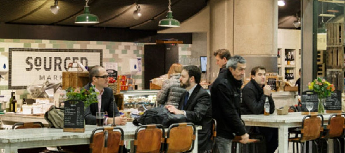 peoplee ating in sourced market restaurant